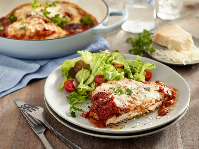 a plate with chicken parmesan and a side salad
