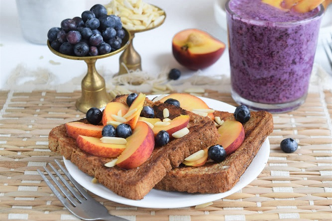 French toast topped with peach slices and blueberries