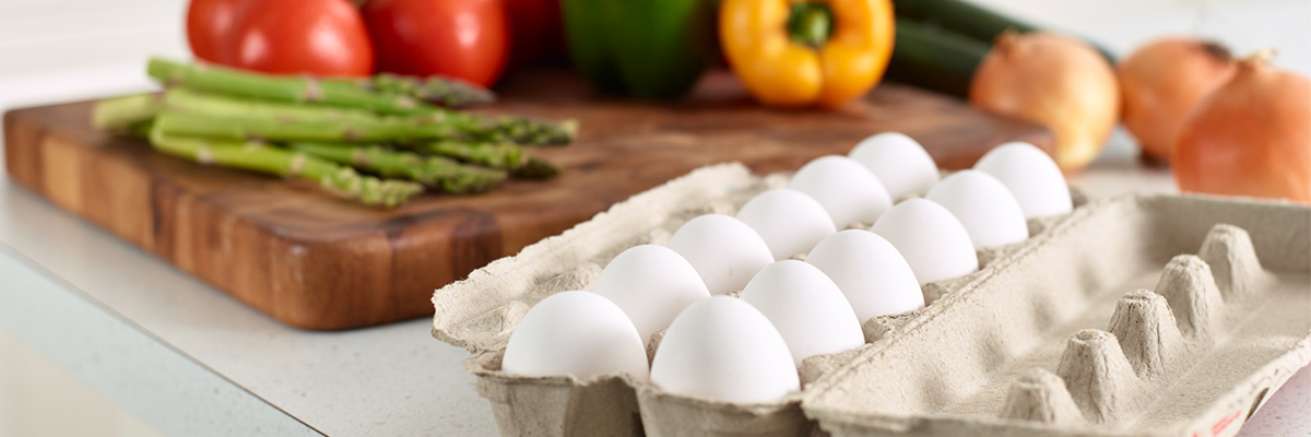 Eggs and vegetables on a cutting